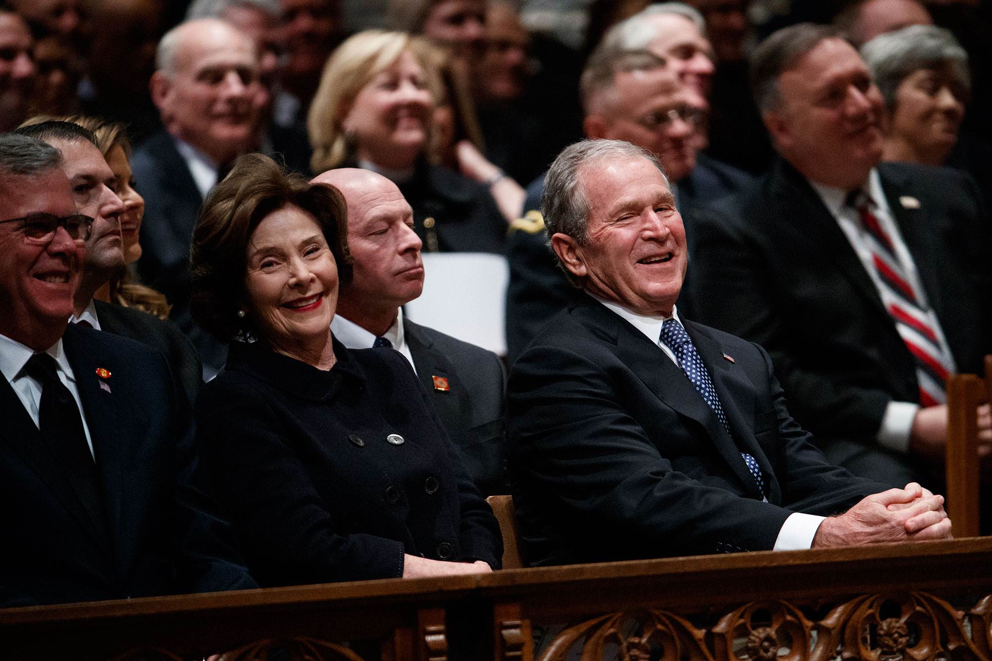 "<div class=""meta image-caption""><div class=""origin-logo origin-image none""><span>none</span></div><span class=""caption-text"">Jeb Bush, Laura Bush, and former President George W. Bush share a laugh as a story is told about former President George H.W. Bush. (Evan Vucci/AP Photo)</span></div>"