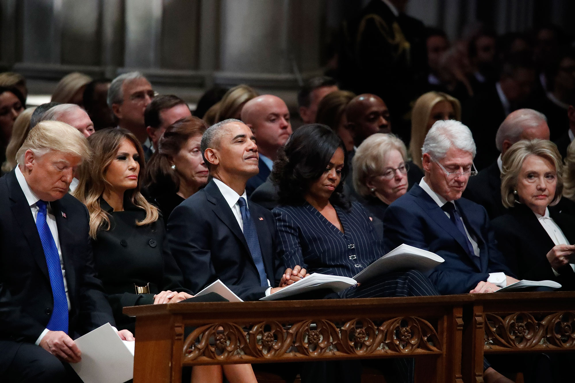 "<div class=""meta image-caption""><div class=""origin-logo origin-image none""><span>none</span></div><span class=""caption-text"">President Donald Trump, first lady Melania Trump, former President Barack Obama, Michelle Obama, former President Bill Clinton and former Secretary of State Hillary Clinton listen. (Alex Brandon, Pool/AP Photo)</span></div>"