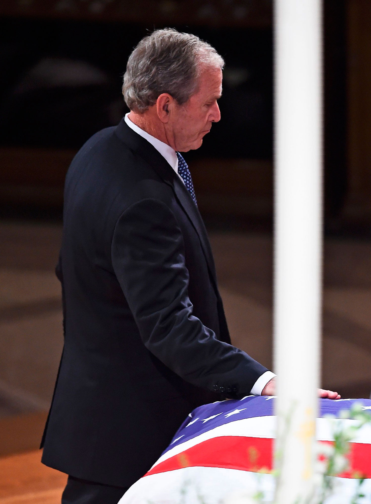 "<div class=""meta image-caption""><div class=""origin-logo origin-image none""><span>none</span></div><span class=""caption-text"">Former president George W. Bush touches the casket as he arrives to give a eulogy at the state funeral of his father former US president George H.W. Bush. (BRENDAN SMIALOWSKI/AFP/Getty Images)</span></div>"