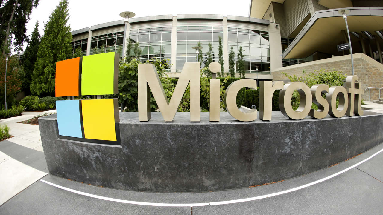 This July 3, 2014 photo shows Microsoft Corp. signage outside the Microsoft Visitor Center in Redmond, Wash.(AP Photo Ted S. Warren)