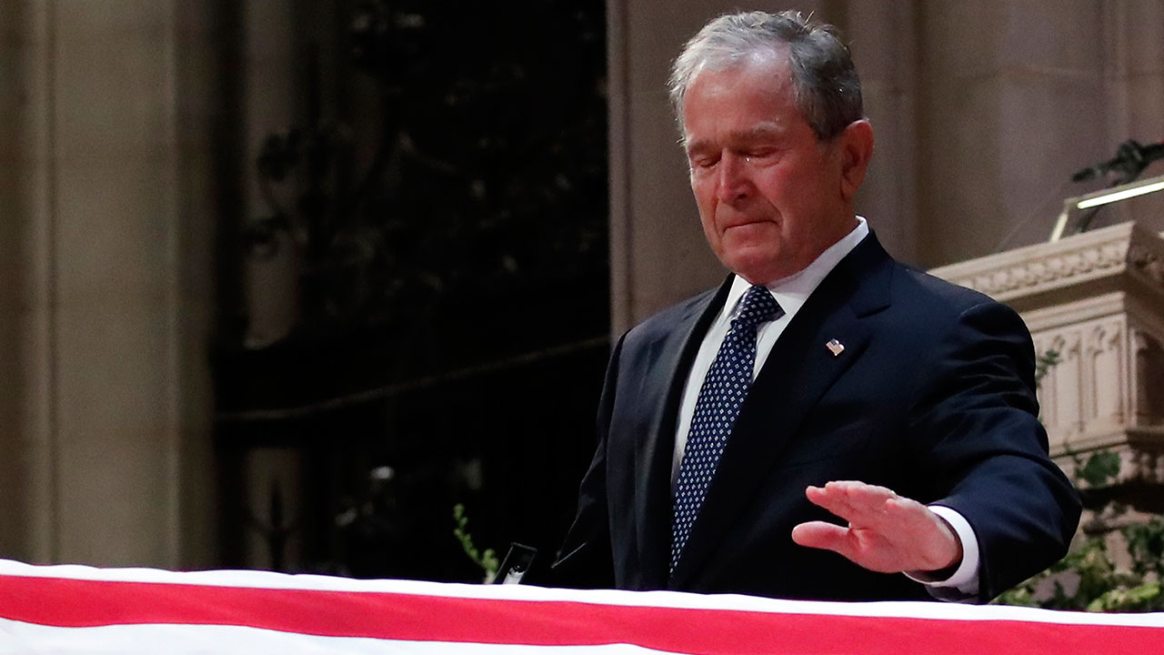 "<div class=""meta image-caption""><div class=""origin-logo origin-image none""><span>none</span></div><span class=""caption-text"">Former President George W. Bush touches the casket of his father, former President George H.W. Bush, at his state funeral. (Alex Brandon, Pool/AP Photo)</span></div>"