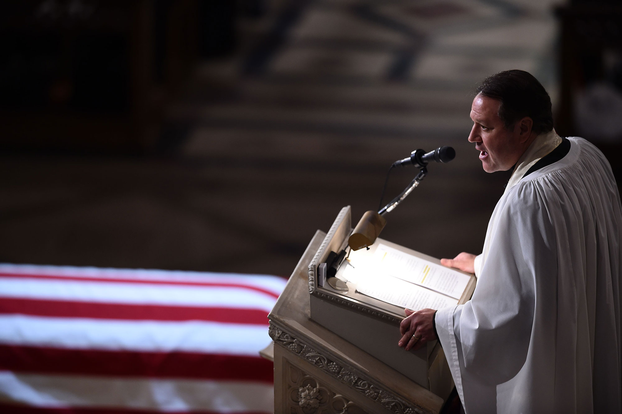 "<div class=""meta image-caption""><div class=""origin-logo origin-image none""><span>none</span></div><span class=""caption-text"">The Reverend Dr. Russell Levenson speaks at the state funeral of former US president George H.W. Bush at the Washington National Cathedral in Washington, December 5, 2018. (BRENDAN SMIALOWSKI/AFP/Getty Images)</span></div>"