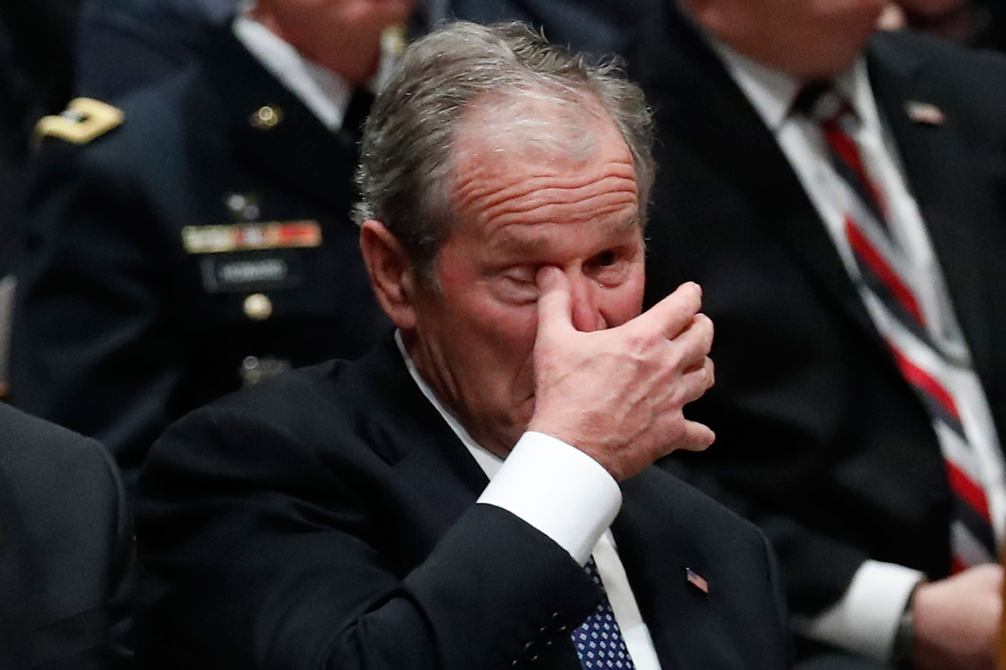 "<div class=""meta image-caption""><div class=""origin-logo origin-image none""><span>none</span></div><span class=""caption-text"">Former President George W. Bush wipes an eye at the State Funeral for his father, former President George H.W. Bush. (Alex Brandon, Pool/AP Photo)</span></div>"