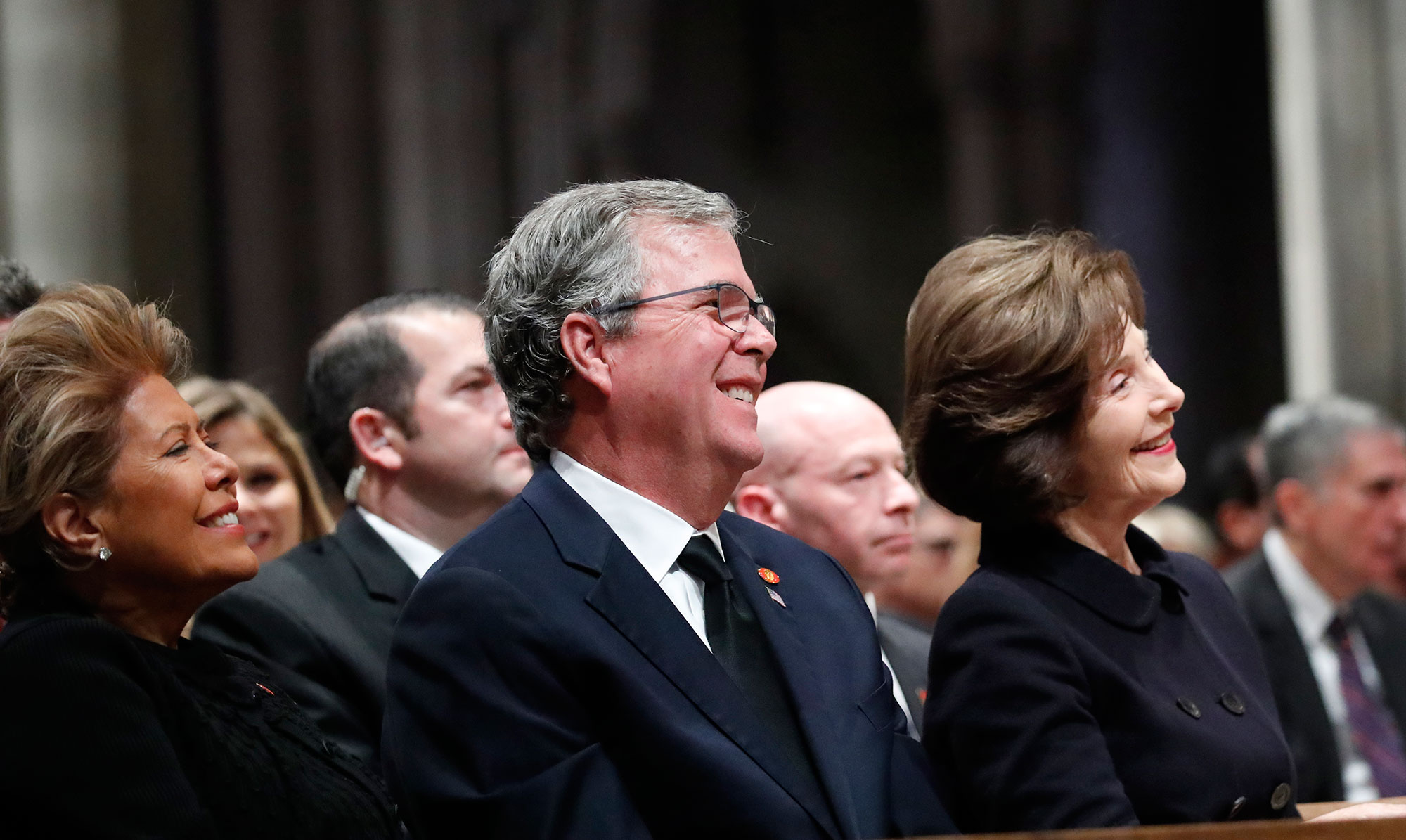 "<div class=""meta image-caption""><div class=""origin-logo origin-image none""><span>none</span></div><span class=""caption-text"">Columba Bush, Jeb Bush and Laura Bush listen as former President George W. Bush speaks during the State Funeral. (Alex Brandon - Pool/Getty Images)</span></div>"