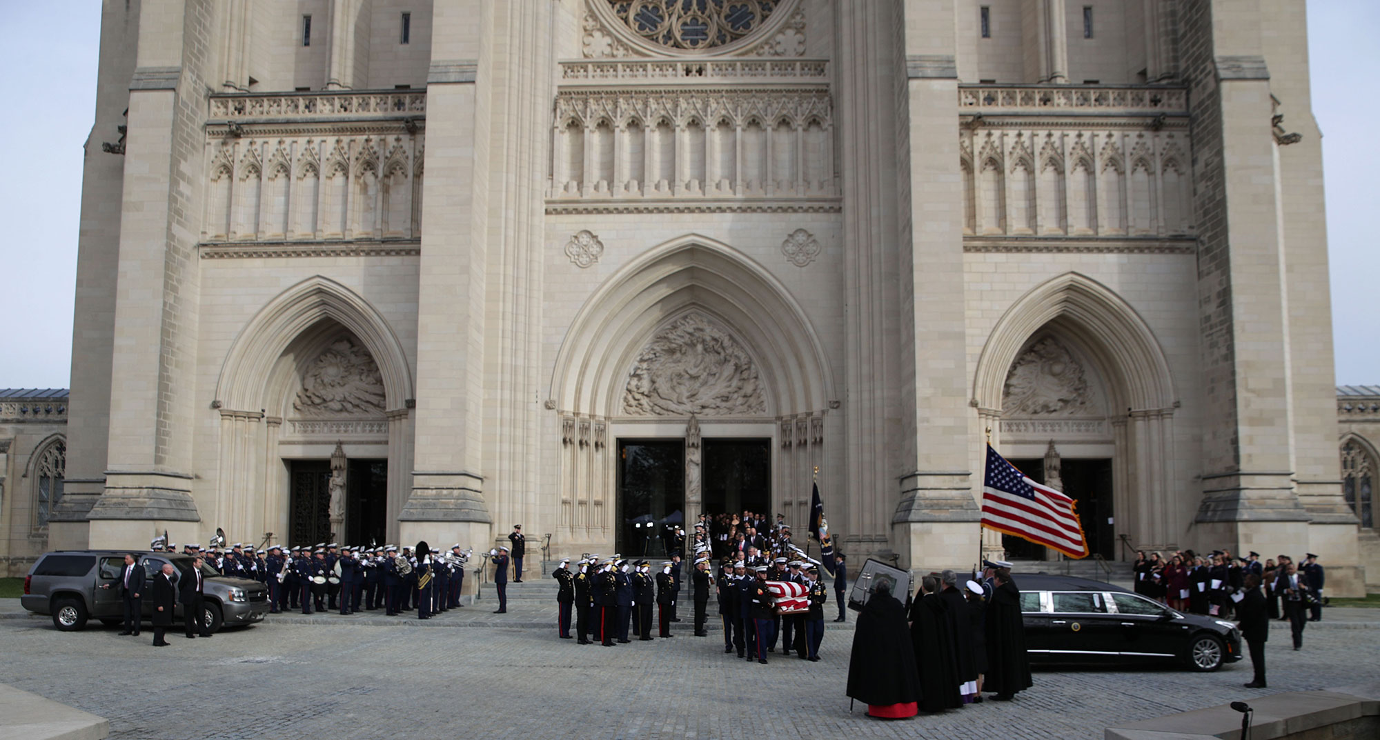 "<div class=""meta image-caption""><div class=""origin-logo origin-image none""><span>none</span></div><span class=""caption-text"">A joint service honor guard carries the casket of former US President George H.W. Bush to an awaiting hearse after his state funeral at the Washington National Cathedral. (Alex Wong/Getty Images)</span></div>"