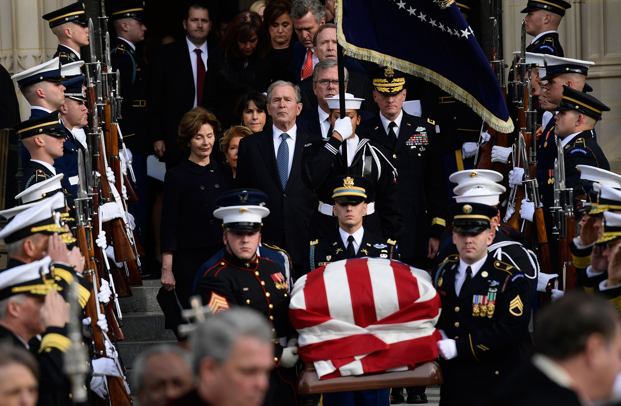 "<div class=""meta image-caption""><div class=""origin-logo origin-image none""><span>none</span></div><span class=""caption-text"">Former President George W. Bush and his wife Laura Bush, center, join their family as they follow the casket of former President George H.W. Bush. (Susan Walsh/AP Photo)</span></div>"
