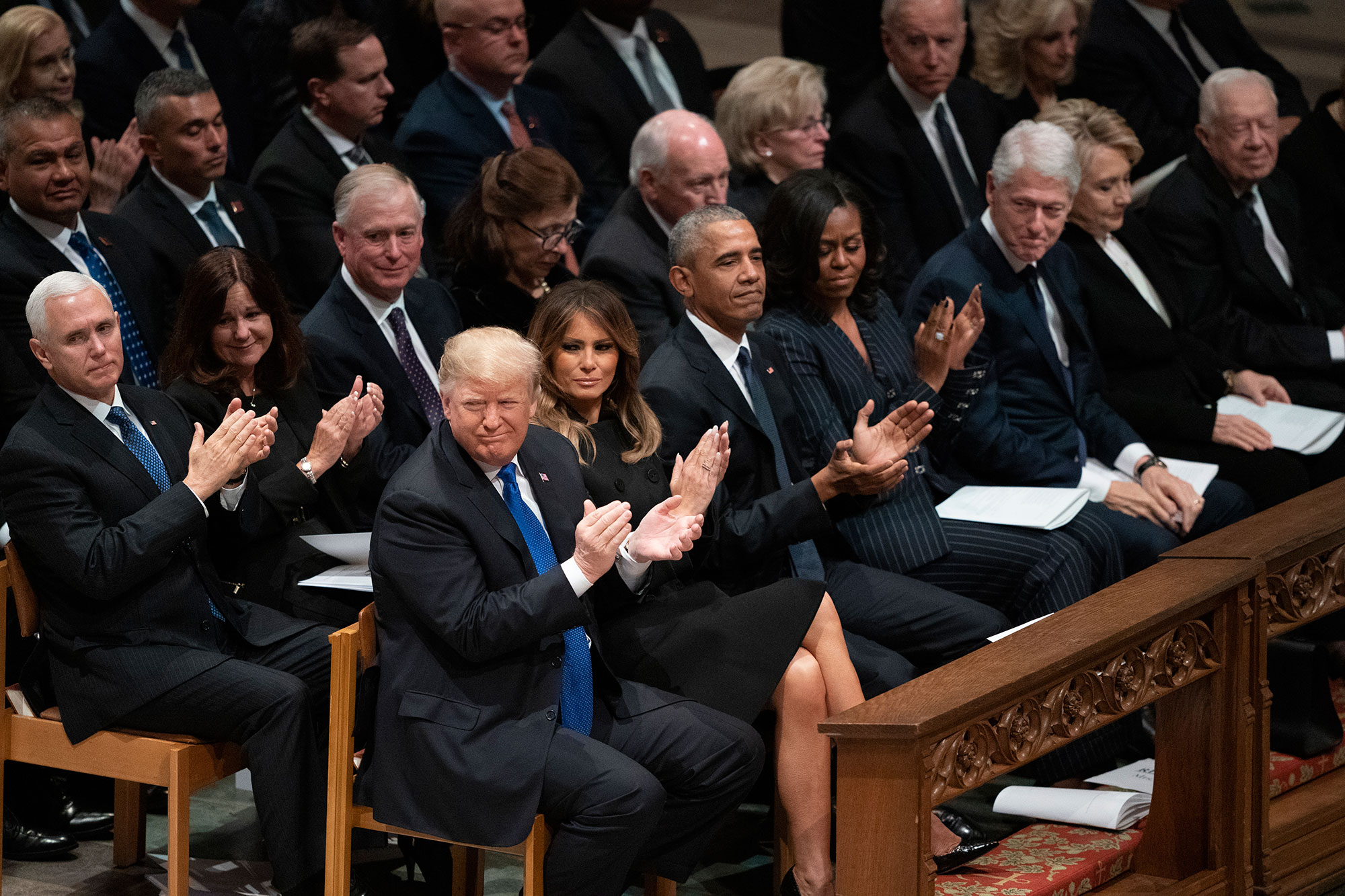 "<div class=""meta image-caption""><div class=""origin-logo origin-image none""><span>none</span></div><span class=""caption-text"">Current and former presidents and first ladies applaud during a State Funeral for former President George H.W. Bush at the National Cathedral, Wednesday, Dec. 5, 2018. (Carolyn Kaster/AP Photo)</span></div>"
