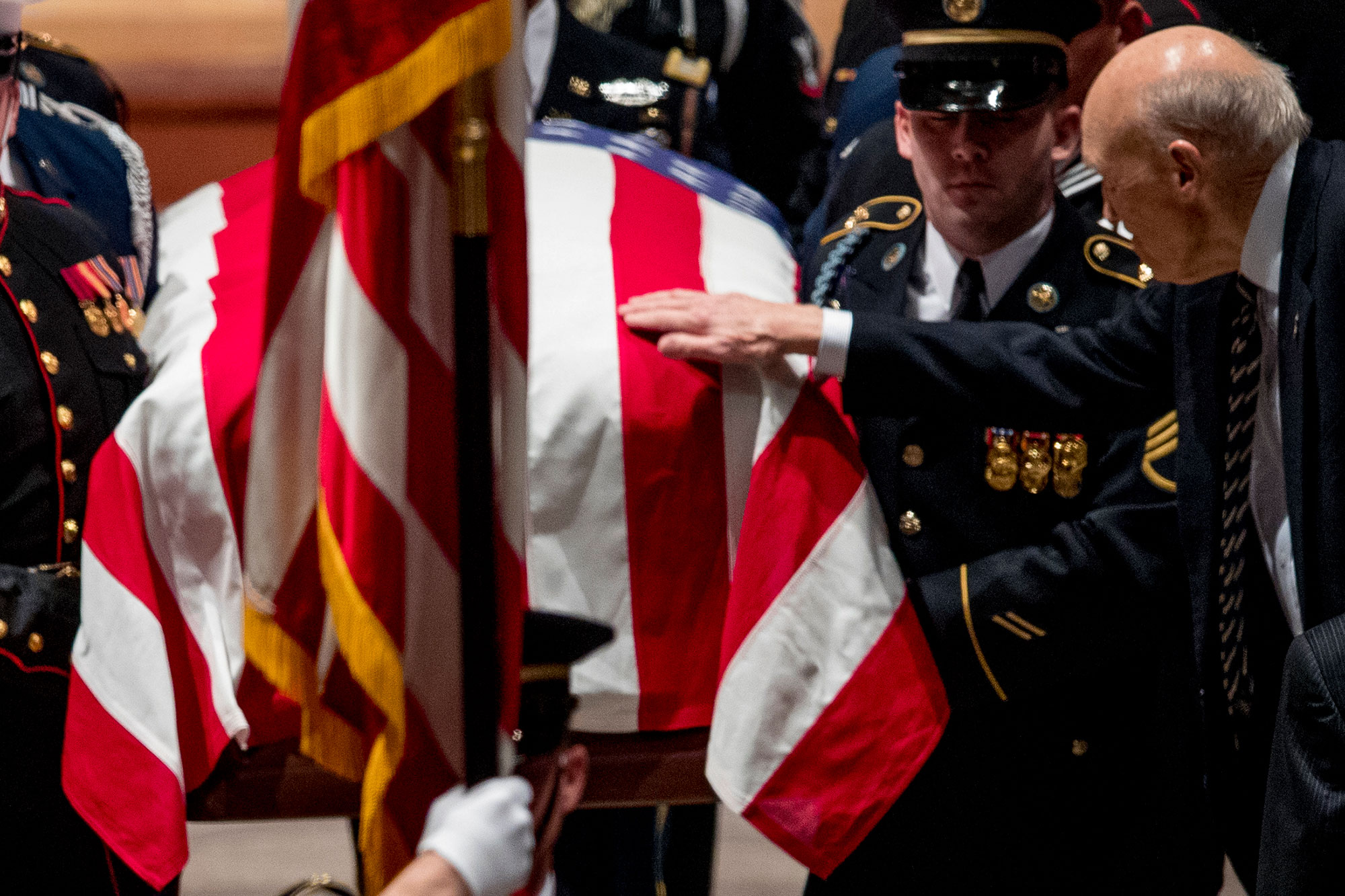 "<div class=""meta image-caption""><div class=""origin-logo origin-image none""><span>none</span></div><span class=""caption-text"">Former Sen. Alan Simpson, R-Wyo, touches the flag-draped casket of former President George H.W. Bush. (Andrew Harnik, Pool/AP Photo)</span></div>"