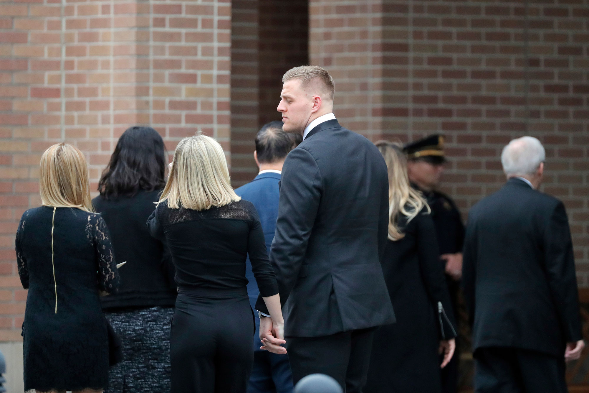 <div class='meta'><div class='origin-logo' data-origin='none'></div><span class='caption-text' data-credit='Gerald Herbert/AP Photo'>Houston Texans' J. J. Watt arrives at a funeral for former President George H.W. Bush at St. Martin's Episcopal Church Thursday, Dec. 6, 2018, in Houston.</span></div>