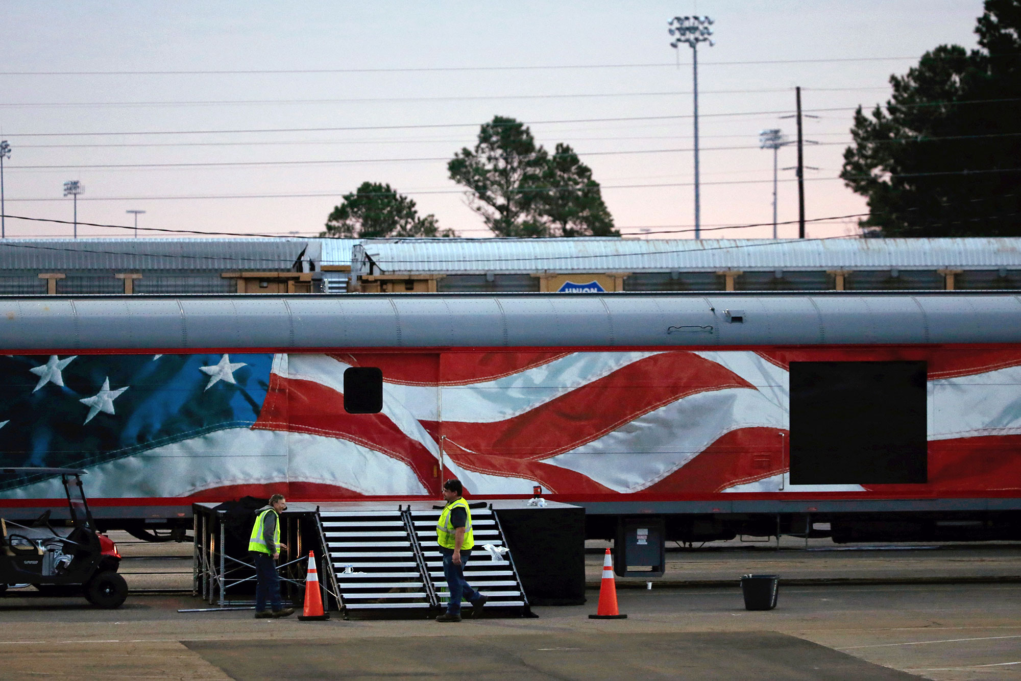 <div class='meta'><div class='origin-logo' data-origin='none'></div><span class='caption-text' data-credit='Kiichiro Sato/AP Photo'>Workers prepare for a departure ceremony of the casket of former President George H.W. Bush at Union Pacific Westfield auto facility Thursday, Dec. 6, 2018, in Spring.</span></div>