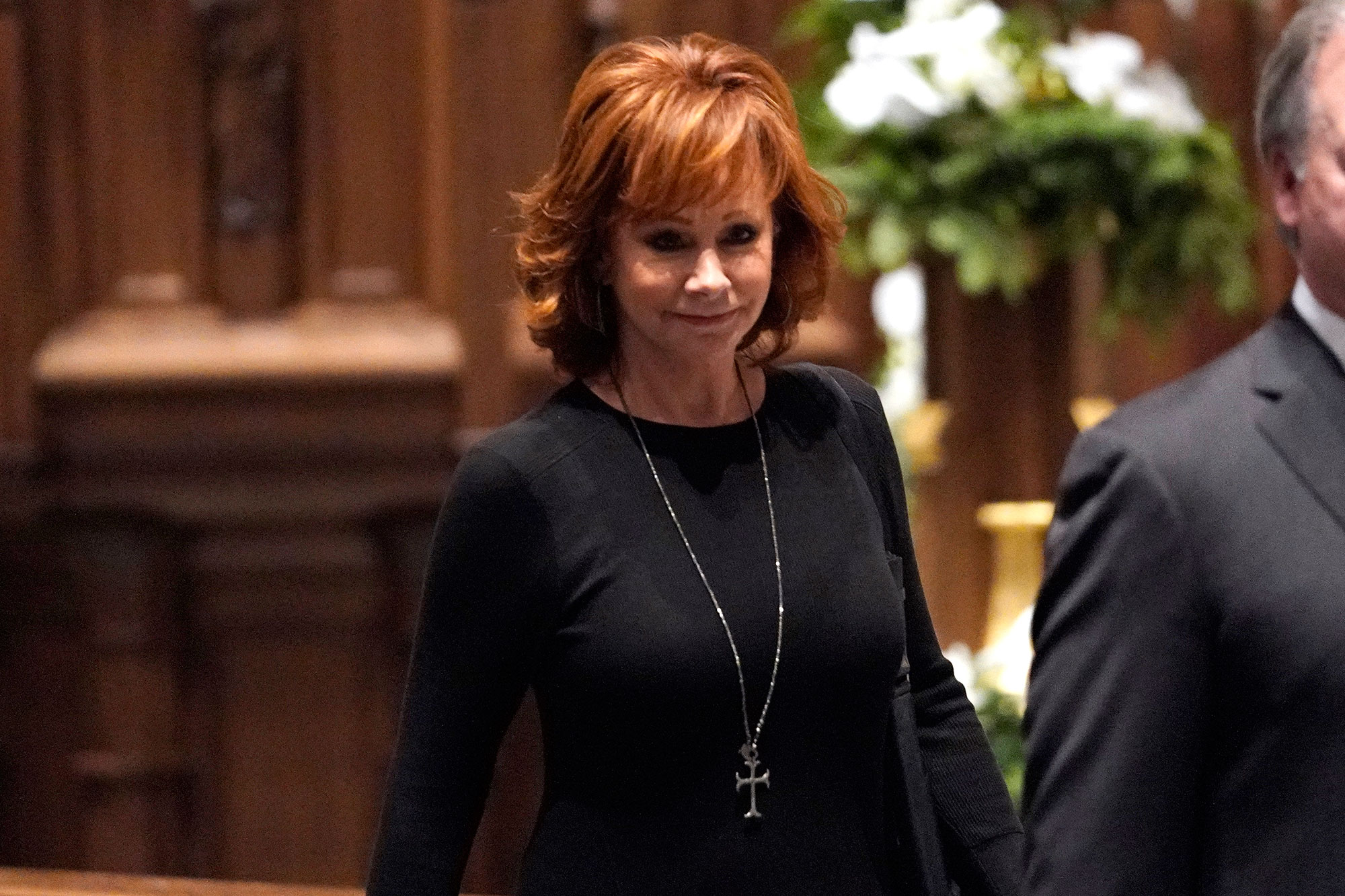 <div class='meta'><div class='origin-logo' data-origin='none'></div><span class='caption-text' data-credit='David J. Phillip, Pool/AP Photo'>Reba McEntire arrives for a funeral service for former President George H.W. Bush at St. Martin's Episcopal Church Thursday, Dec. 6, 2018, in Houston.</span></div>