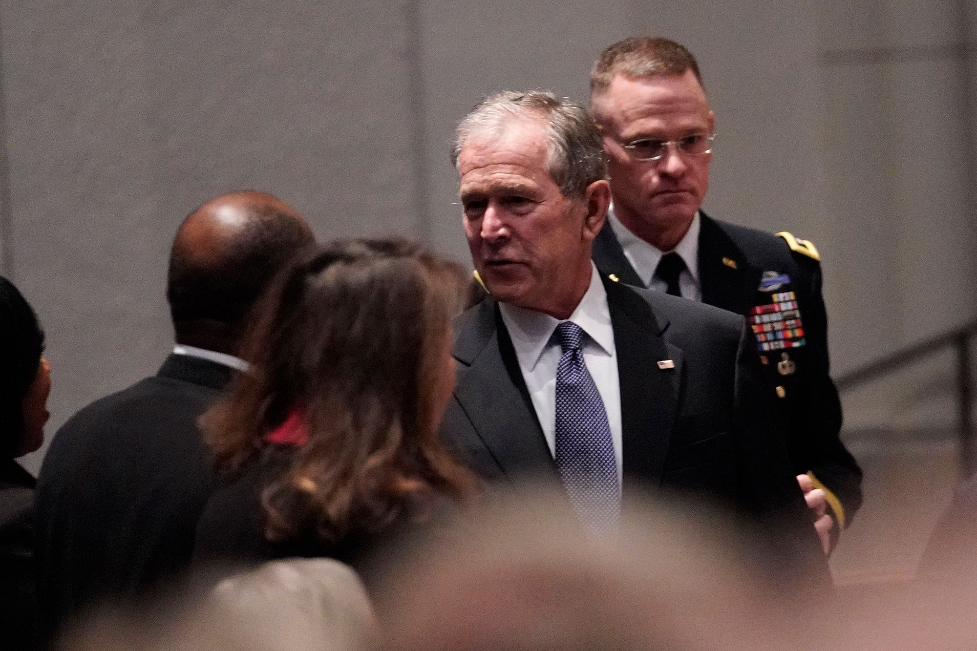 <div class='meta'><div class='origin-logo' data-origin='none'></div><span class='caption-text' data-credit='David J. Phillip, Pool/AP Photo'>Former President George W. Bush arrives for a funeral service for former President George H.W. Bush at St. Martin's Episcopal Church Thursday, Dec. 6, 2018, in Houston.</span></div>