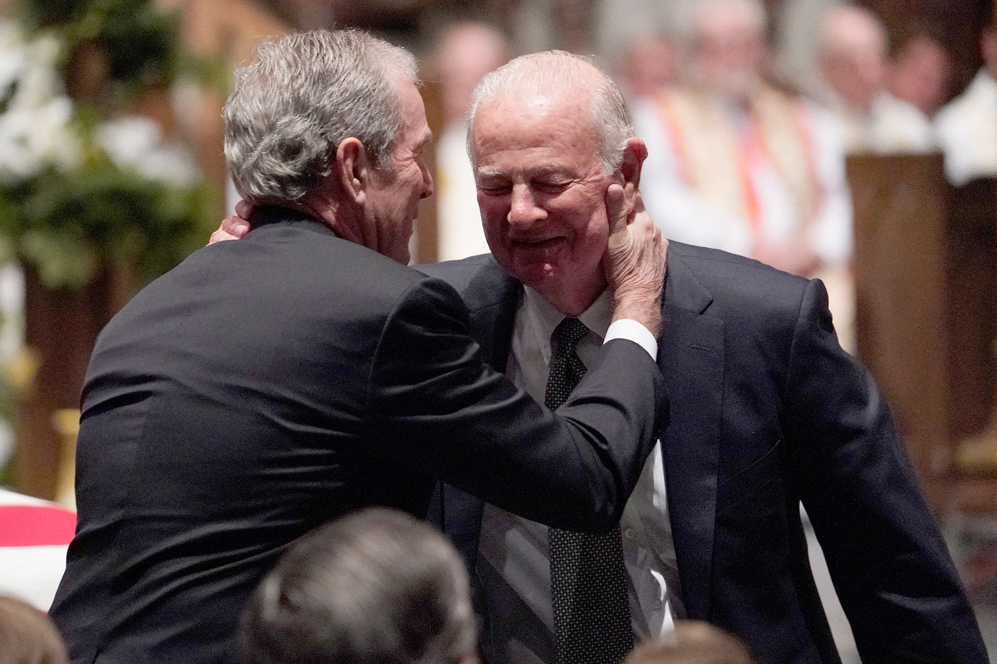 <div class='meta'><div class='origin-logo' data-origin='none'></div><span class='caption-text' data-credit='David J. Phillip-Pool/Getty Images'>Former President George W. Bush embraces former Secretary of State James Baker, right, after he gave a eulogy during the funeral for former President George H.W. Bush.</span></div>