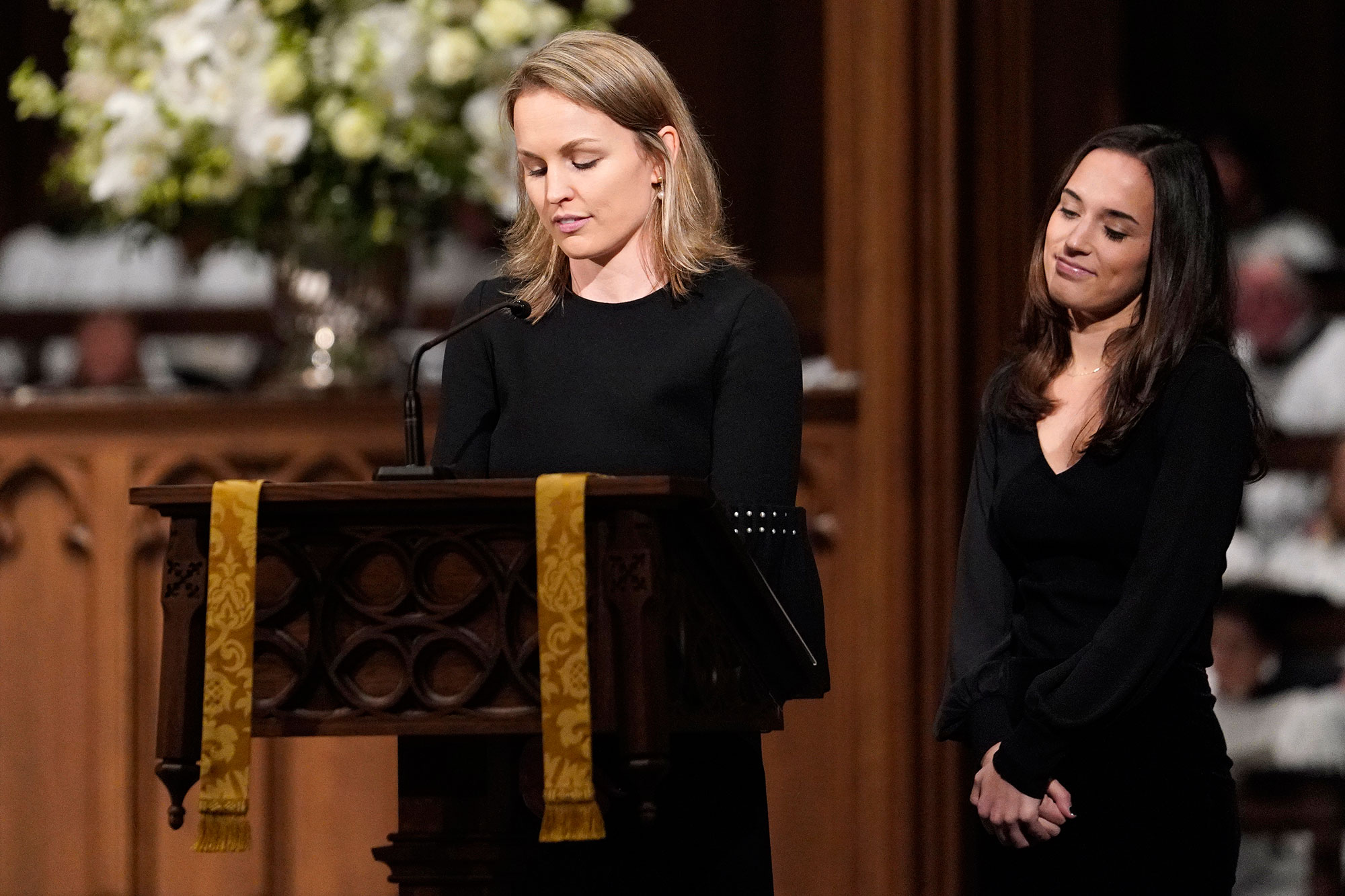 <div class='meta'><div class='origin-logo' data-origin='none'></div><span class='caption-text' data-credit='David J. Phillip, Pool/AP Photo'>Granddaughters Nancy Ellis LeBlond Sosa, left, and Georgia Grace Koch read scripture during a funeral service for former President George H.W. Bush.</span></div>