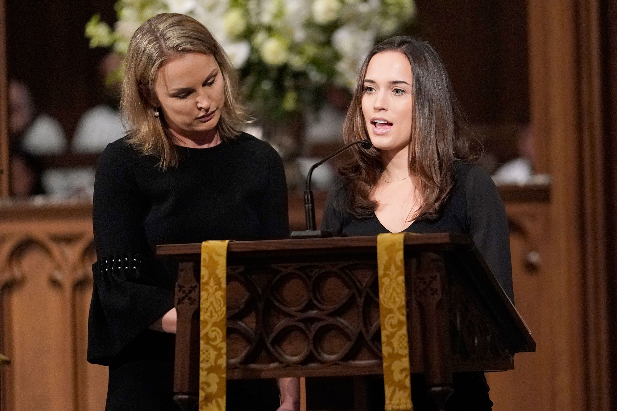 "<div class=""meta image-caption""><div class=""origin-logo origin-image none""><span>none</span></div><span class=""caption-text"">Nancy Ellis LeBlond Sosa, left, and Georgia Grace Koch read scripture during a funeral service for former President George H.W. Bush at St. Martin's Episcopal Church Thursday. (David J. Phillip, Pool/AP Photo)</span></div>"