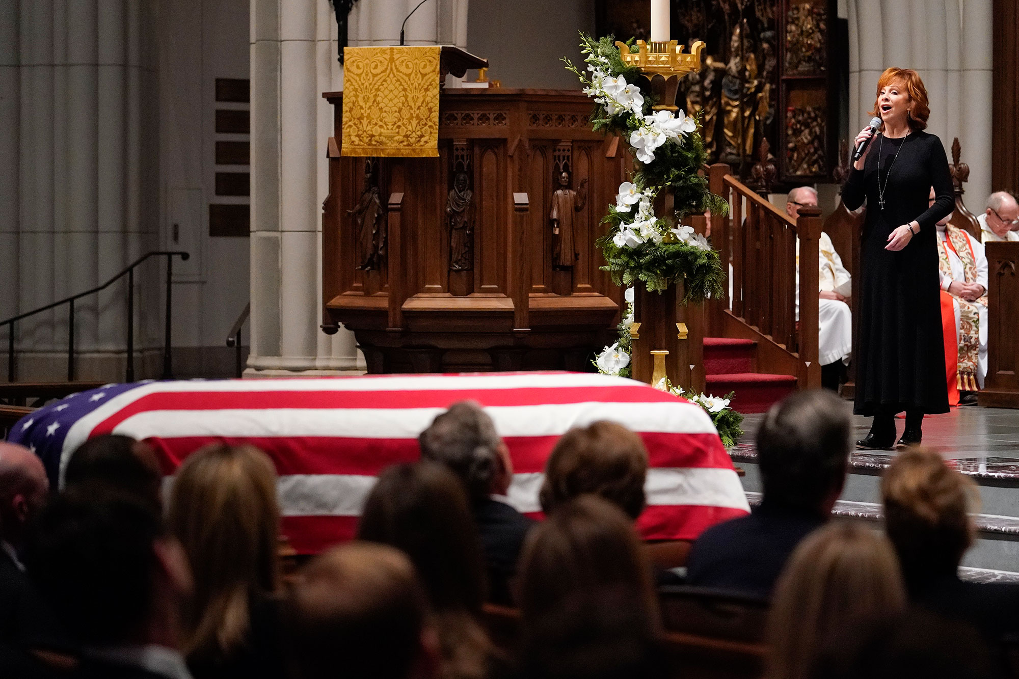 "<div class=""meta image-caption""><div class=""origin-logo origin-image none""><span>none</span></div><span class=""caption-text"">Reba McEntire sings ""The Lord's Prayer"" during a funeral service for former President George H.W. Bush at St. Martin's Episcopal Church Thursday, Dec. 6, 2018, in Houston. (David J. Phillip, Pool/AP Photo)</span></div>"