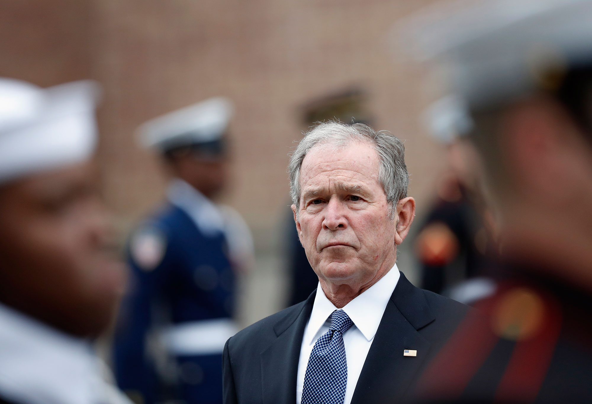 "<div class=""meta image-caption""><div class=""origin-logo origin-image none""><span>none</span></div><span class=""caption-text"">Former President George W. Bush leaves St. Martin's Episcopal Church in Houston after the funeral service for his father, former President George H.W. Bush. (Gerald Herbert/AP Photo)</span></div>"