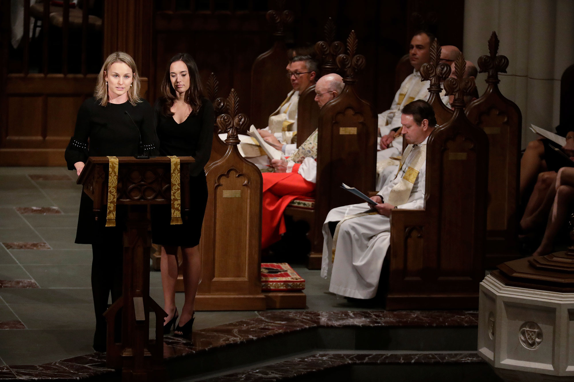 "<div class=""meta image-caption""><div class=""origin-logo origin-image none""><span>none</span></div><span class=""caption-text"">Granddaughters Nancy Ellis LeBlond Sosa, left, and Georgia Grace Koch read scripture during a funeral for former President George H.W. Bush at St. Martin's Episcopal Church. (Mark Humphrey/AP Photo)</span></div>"