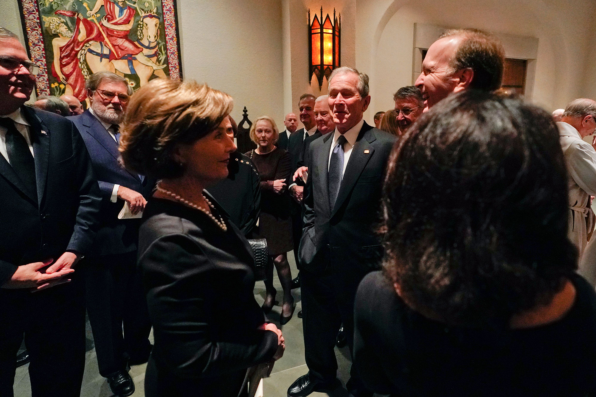 <div class='meta'><div class='origin-logo' data-origin='none'></div><span class='caption-text' data-credit='David J. Phillip, Pool/AP Photo'>Former President George W. Bush and Laura Bush talk with Neil Bush and his wife Maria, right, after a funeral service for former President George H.W. Bush.</span></div>