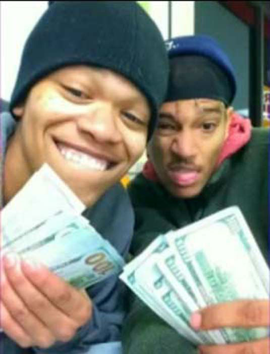 "<div class=""meta image-caption""><div class=""origin-logo origin-image ""><span></span></div><span class=""caption-text"">Dorian Walker and Dillan Thompson seen in a selfie taken with the stolen iPad. (KTRK Photo/ YouTube)</span></div>"