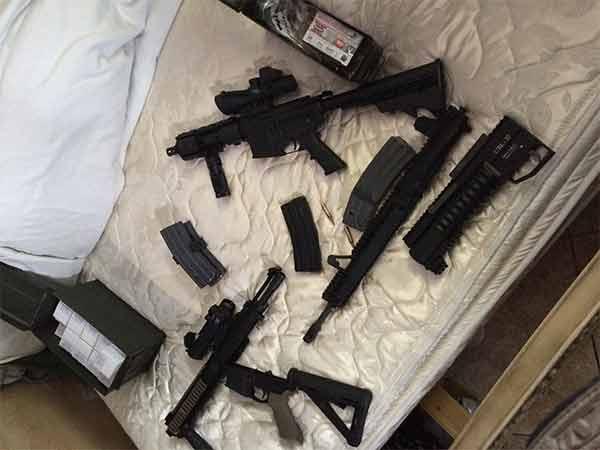 Weapons were discovered inside a San Bernardino home following a standoff on Thursday, Jan. 22, 2015.
