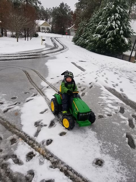 <div class='meta'><div class='origin-logo' data-origin='none'></div><span class='caption-text' data-credit='Tiffany Peters'>Easton driving his John Deere tractor in Clayton</span></div>