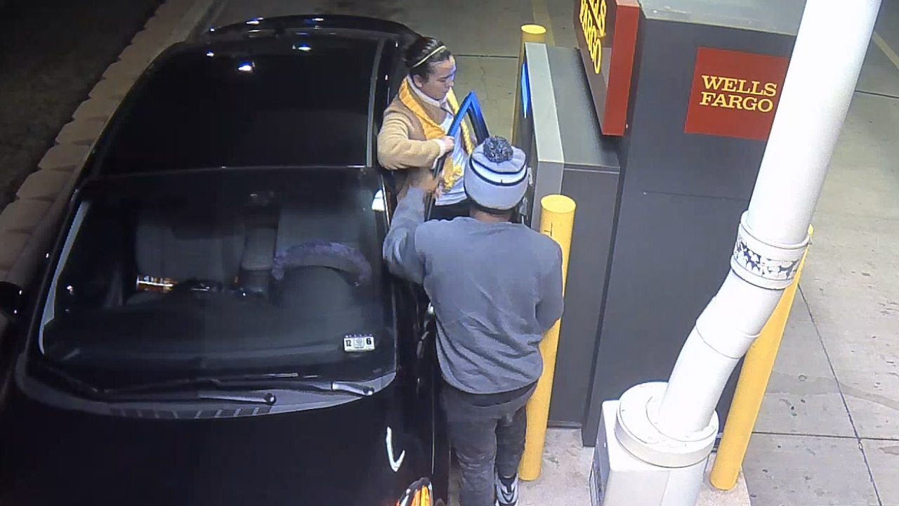 Surveillance video show a male suspect robbing and kidnapping a woman stopped at an ATM in Texas on Jan. 14, 2015.