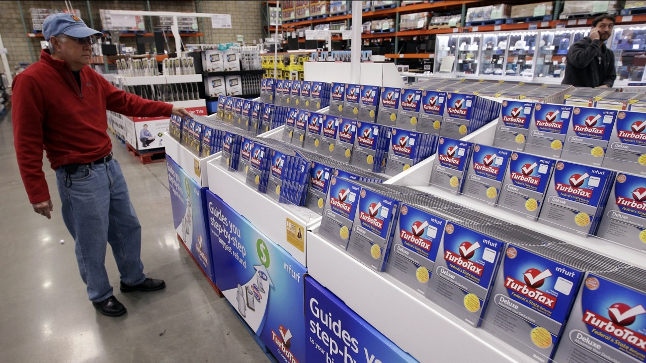 A shopper looks at a copy of TurboTax on sale at Costco.