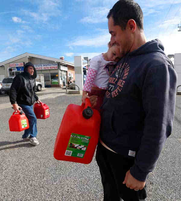 "<div class=""meta image-caption""><div class=""origin-logo origin-image none""><span>none</span></div><span class=""caption-text"">Chris Ferrone, right, carries his 3-year-old daughter Kora as she holds on to a five-gallon gas can while waiting in line to fill up at a gas station in Toms River, N.J. Nov.1 '12</span></div>"