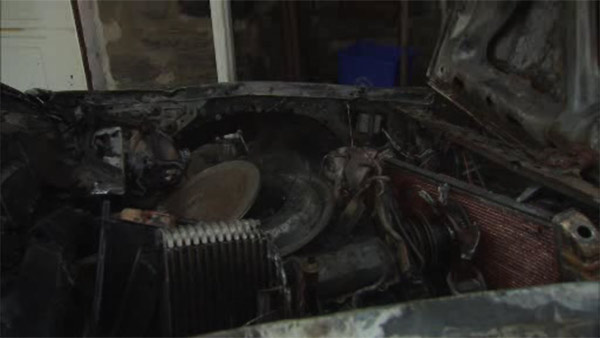 Flames erupt in car with bad battery