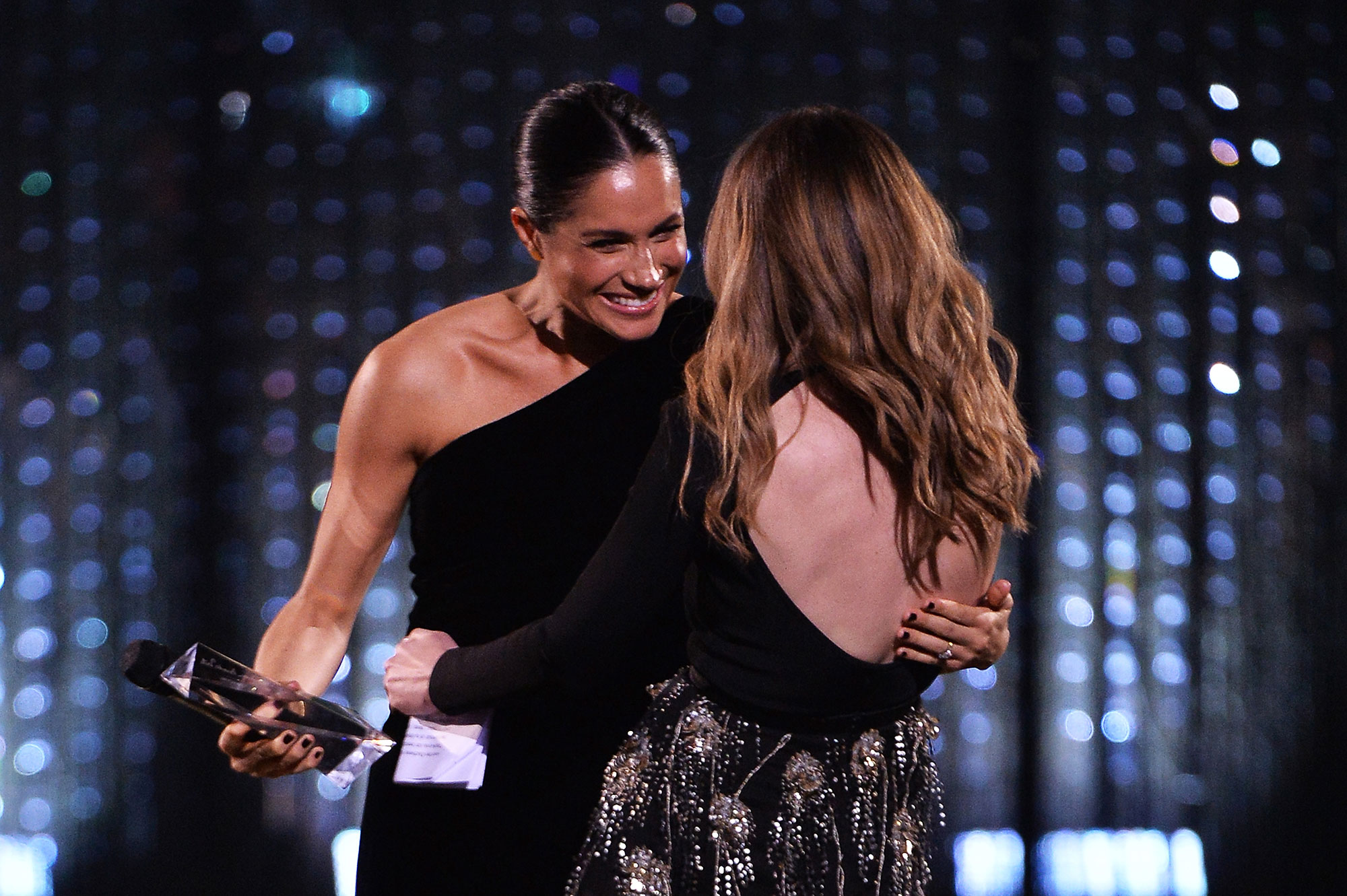 """<div class=""""meta image-caption""""><div class=""""origin-logo origin-image none""""><span>none</span></div><span class=""""caption-text"""">Meghan, Duchess of Sussex presents the award for British Designer of the Year Womenswear Award to Clare Waight Keller for Givenchy during The Fashion Awards 2018. (Jeff Spicer/BFC/Getty Images)</span></div>"""
