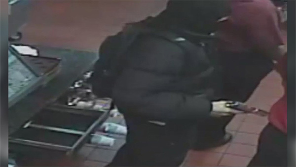 Philadelphia Police investigate a robbery at a McDonald's Restaurant in Rhawnhurst.