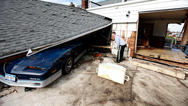 "<div class=""meta image-caption""><div class=""origin-logo origin-image none""><span>none</span></div><span class=""caption-text"">Freddie Nocella, Jr., looks at his grandfather's crushed Trans Am as he salvages belongings from his grandparents' damaged home after Sandy, Oct. 31, 2012, in Babylon Village, N.Y.</span></div>"
