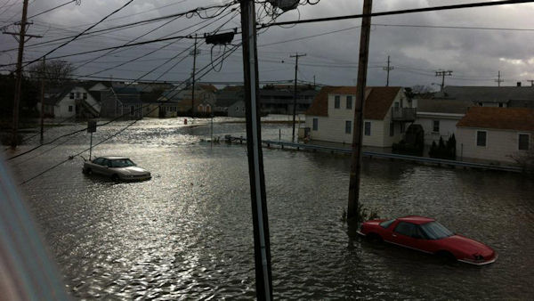 "<div class=""meta image-caption""><div class=""origin-logo origin-image none""><span>none</span></div><span class=""caption-text"">A flooded street in Seaside Heights, N.J., is seen in the wake of Superstorm Sandy on Tuesday, Oct. 30, 2012. (Tim Husar and Jan Humphreys)</span></div>"