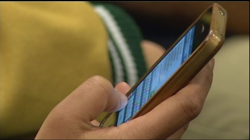 Some schools ban cellphones because parents won't stop texting