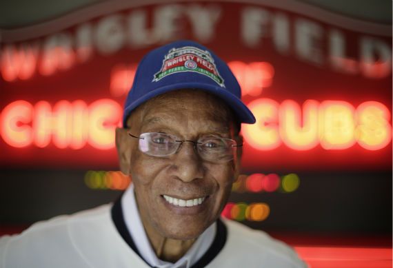"""<div class=""""meta image-caption""""><div class=""""origin-logo origin-image none""""><span>none</span></div><span class=""""caption-text"""">In this March 24, 2014, photo Chicago Cubs' Hall of Famer Ernie Banks smiles after an interview at the Cubs offices in Chicago. (AP Photo/M. Spencer Green) (WLS Photo/ M. Spencer Green)</span></div>"""