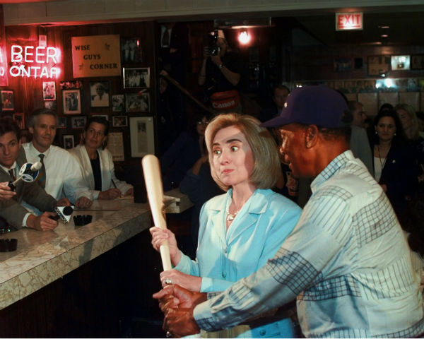 """<div class=""""meta image-caption""""><div class=""""origin-logo origin-image none""""><span>none</span></div><span class=""""caption-text"""">Hillary Rodham Clinton poses for photographers with Chicago Cubs legend Ernie Banks during a visit to Chicago's famed Billy Goat Tavern on Aug. 28, 1996. (AP Photo/Ruth Fremson) (AP Photo/ RUTH FREMSON)</span></div>"""