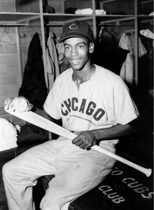 """<div class=""""meta image-caption""""><div class=""""origin-logo origin-image none""""><span>none</span></div><span class=""""caption-text"""">Ernie Banks of the Chicago Cubs holds his grand slam bat and ball after setting a new record with his fifth bases-loaded homer in St. Louis, Mo., Sept. 19, 1955.  (AP Photo) (AP Photo/ XNBG)</span></div>"""