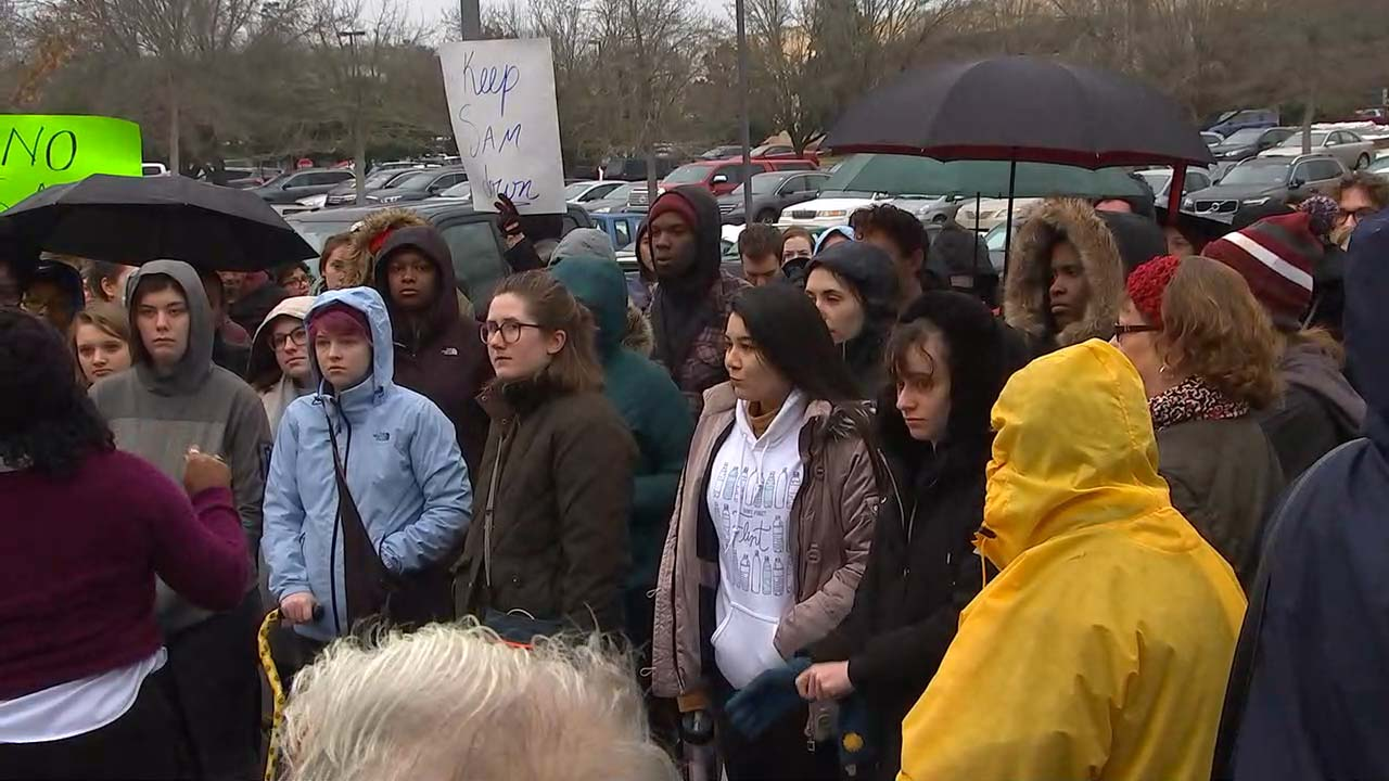 "<div class=""meta image-caption""><div class=""origin-logo origin-image wtvd""><span>WTVD</span></div><span class=""caption-text"">Protesters gather outside on UNC's campus to show their views against Silent Sam</span></div>"