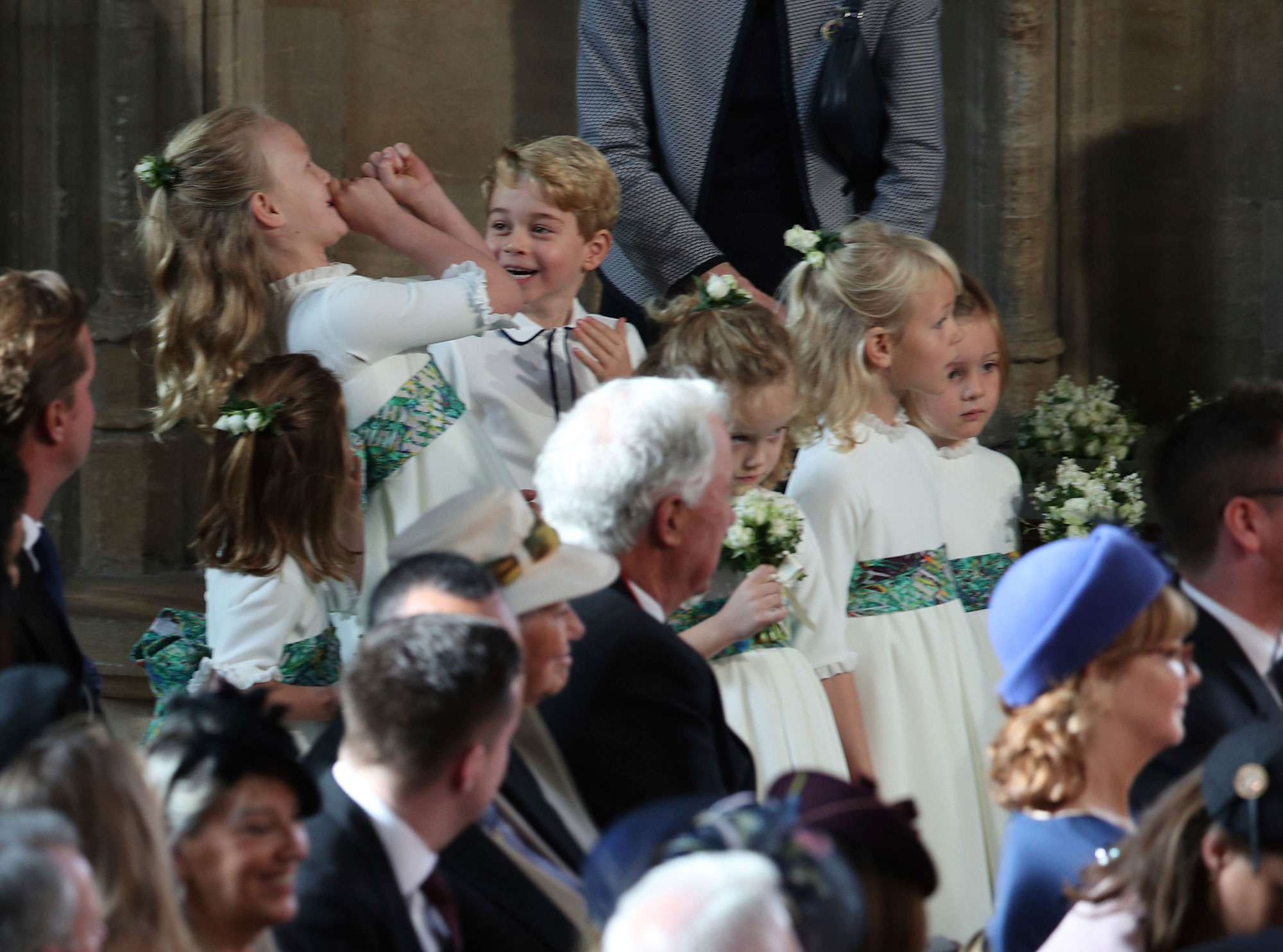 <div class='meta'><div class='origin-logo' data-origin='none'></div><span class='caption-text' data-credit='Yui Mok, Pool via AP'>The bridesmaids and page boys, including Prince George and Princess Charlotte, arrive for the wedding of Princess Eugenie of York and Jack Brooksbank on Oct. 12, 2018</span></div>
