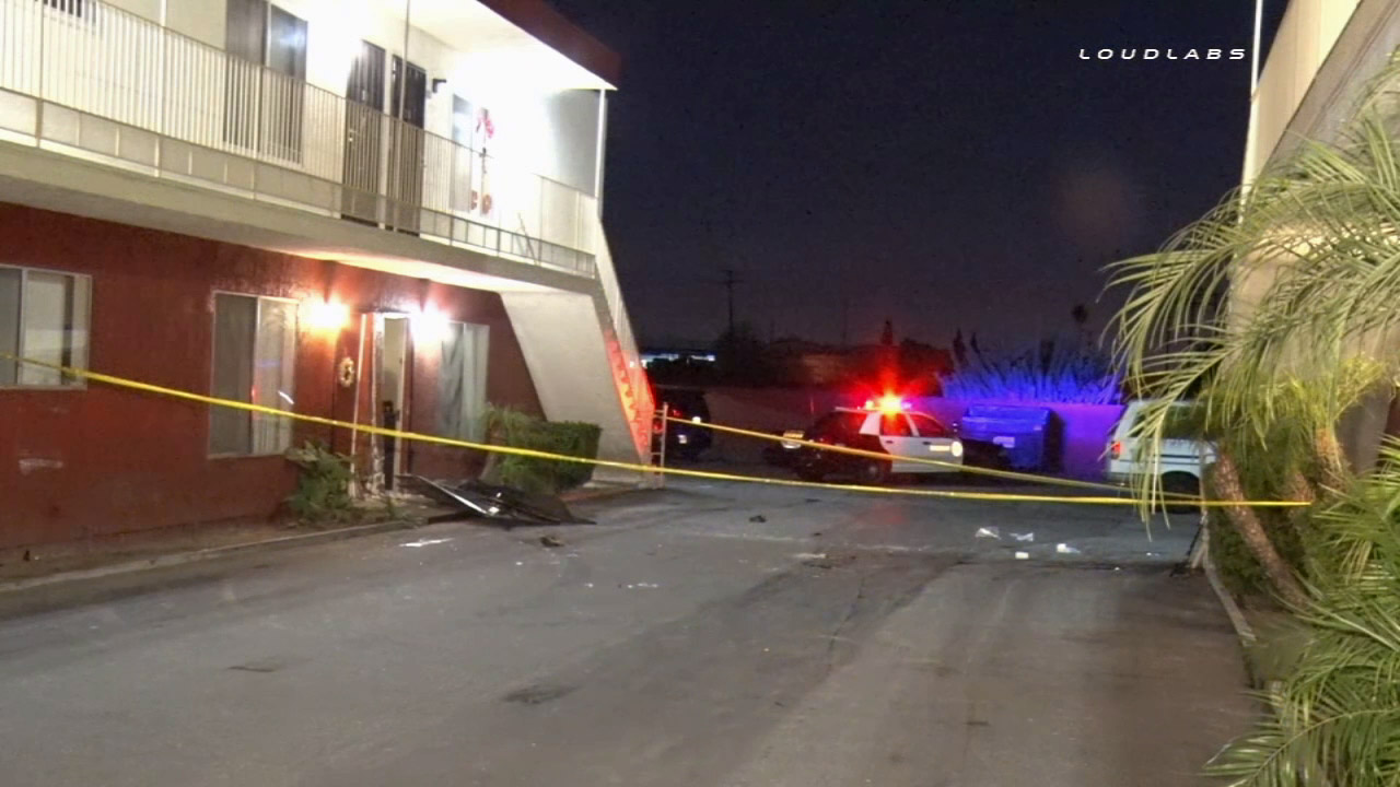 Sheriff's deputies investigate after a car slammed into an apartment building in Pico Rivera on Saturday, Jan. 24, 2015.