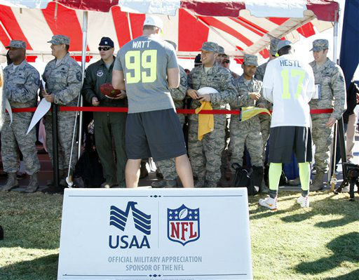 """<div class=""""meta image-caption""""><div class=""""origin-logo origin-image """"><span></span></div><span class=""""caption-text"""">NFL Pro Bowlers J.J. Watt, left, and Devin Hester, right, sign autographs for service members during an NFL Pro Bowl practice at Luke Air Force Base (Photo/Rick Scuteri)</span></div>"""