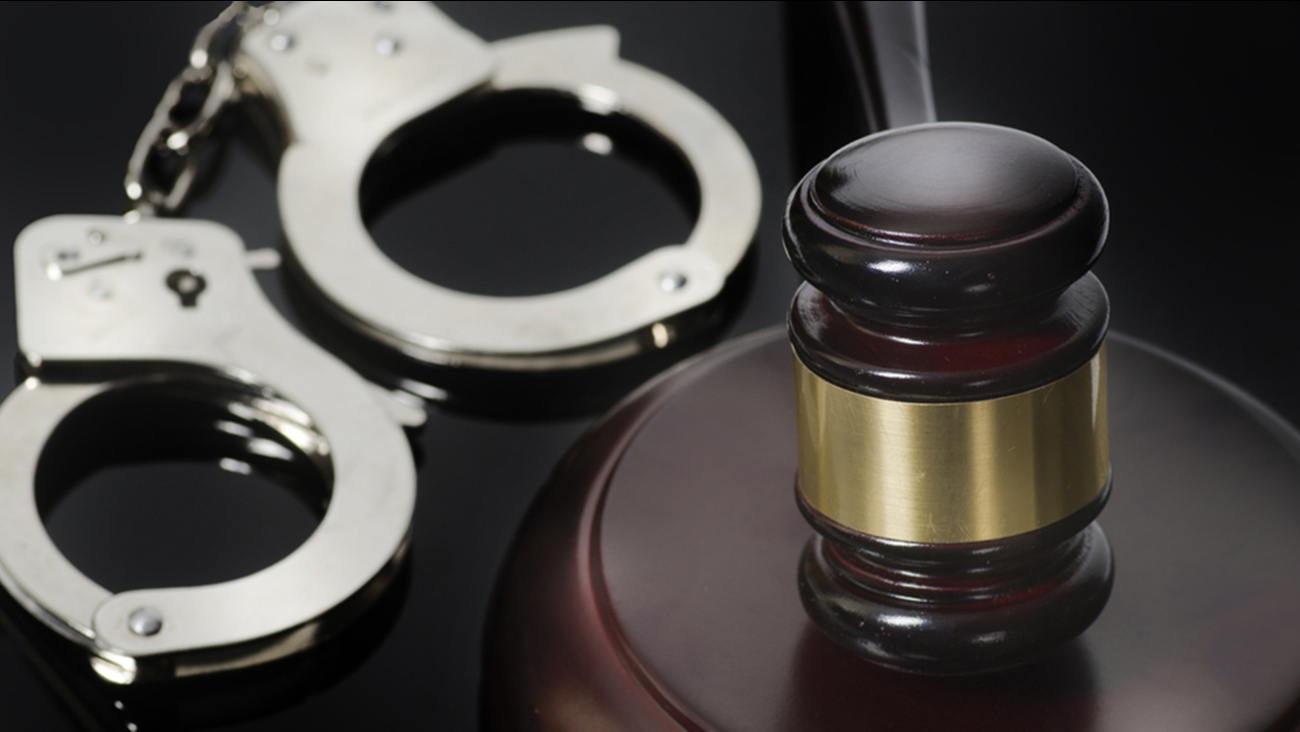 Handcuffs and a judge's gavel