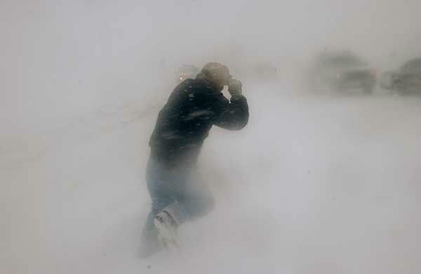"""<div class=""""meta image-caption""""><div class=""""origin-logo origin-image none""""><span>none</span></div><span class=""""caption-text"""">Dec. 2006: A motorist tries to help another through low visibility during a blizzard in Colorado. (Photo/PETER M. FREDIN)</span></div>"""
