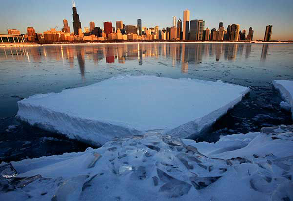 """<div class=""""meta image-caption""""><div class=""""origin-logo origin-image none""""><span>none</span></div><span class=""""caption-text"""">Feb. 2011: A blizzard swept through Chicago, stranding commuters and burying the city under snow. (Photo/Charles Rex Arbogast)</span></div>"""