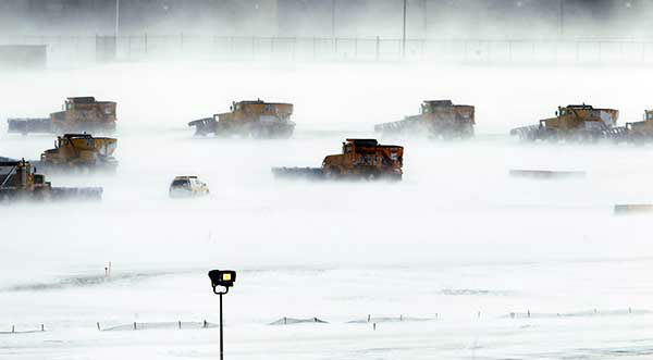 """<div class=""""meta image-caption""""><div class=""""origin-logo origin-image none""""><span>none</span></div><span class=""""caption-text"""">Dec. 2010: Machines work to clear the runways at Philadelphia International Airport after a Christmas Day storm plowed up and down the east coast. (Photo/Matt Rourke)</span></div>"""
