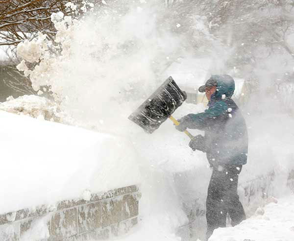 """<div class=""""meta image-caption""""><div class=""""origin-logo origin-image none""""><span>none</span></div><span class=""""caption-text"""">Feb. 2010: A man tries to shovel in front of his home in Annapolis, Md., but the task is made difficult by the blizzard winds. (Photo/Susan Walsh)</span></div>"""