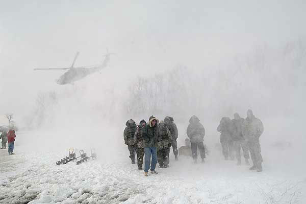 """<div class=""""meta image-caption""""><div class=""""origin-logo origin-image none""""><span>none</span></div><span class=""""caption-text"""">March 2009: Members of the National Guard meet the governor of North Dakota during a blizzard. Nearby, explosive experts tried to clear the frozen Missouri River. (Photo/Tom Stromme)</span></div>"""