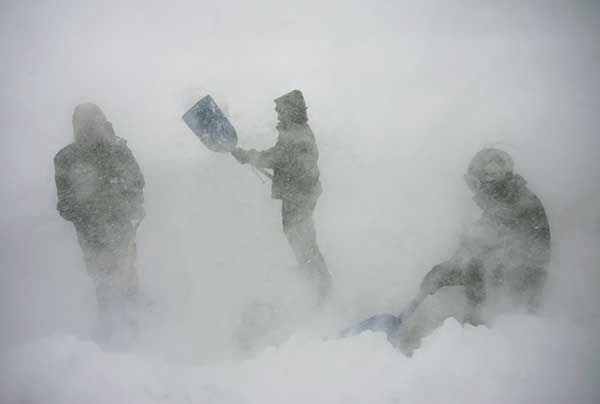 """<div class=""""meta image-caption""""><div class=""""origin-logo origin-image none""""><span>none</span></div><span class=""""caption-text"""">Nov. 2007: Employees of a resort in Hope Valley, Calif. work to keep it operational during a blizzard. (Photo/Chad Lundquist)</span></div>"""