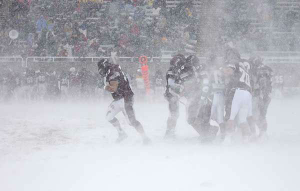 """<div class=""""meta image-caption""""><div class=""""origin-logo origin-image none""""><span>none</span></div><span class=""""caption-text"""">Nov. 2003: A college football game between Massachusetts and Colgate continues in Hamilton, N.Y., despite the blizzard-like conditions. (Photo/KEVIN RIVOLI)</span></div>"""